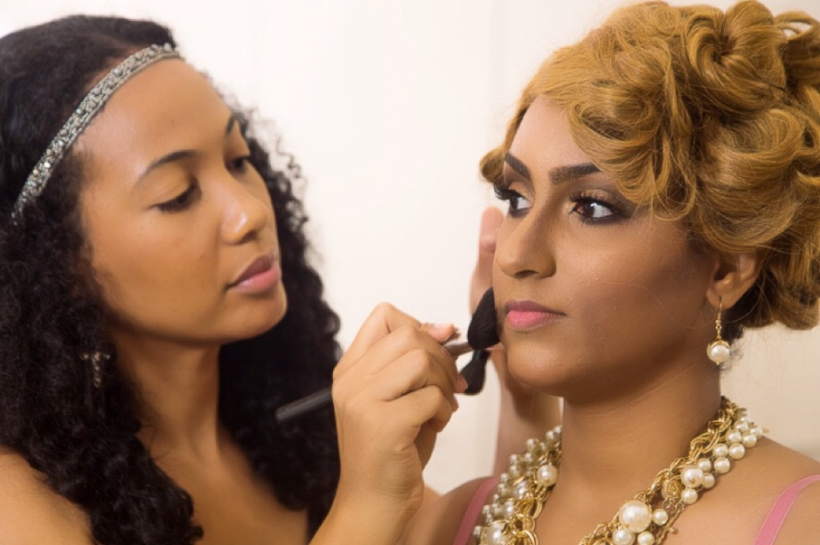 Sandra Don Arthur applying makeup to Juliet Ibrahim