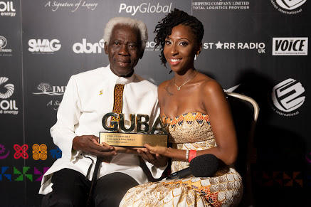 Mr Ernest Abbeyquaye with award, host Claire Clottey (right)